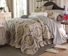 Uffizi Bedding Collection An antique Florentine medallion print is the essence of modern sophistication recast in neutral shades of grey, taupe and champagne. Sewn of pure cotton, every medallion is outlined with contrast pick-stitching, which shows through on the quilt's solid grey voile reverse. Beautifully finished with rounded corners and braided cording trim, the look is even more opulent when layered with other rich textures.