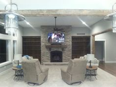 Fireplace with built-ins and wood barn beam trimmed openings
