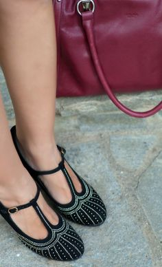 I love these T-strap shoes. It's the right mix of elegance and chic.