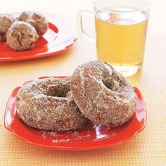 Apple Cider Doughnuts recipe coated with cinnamon sugar. Perfect with coffee or cider!