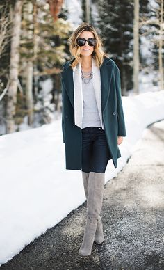 coat, skinny pants, and grey boots