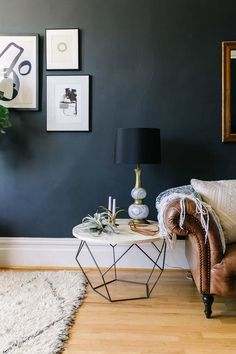 Modern Industrial Home Interior Design Inspiration featuring round coffee table used as end table next to brown leather couch with white throw, navy wall, boho rug Home Living Room, Living Room Decor, Living Spaces, Dark Walls Living Room, Dining Room, Bedroom Decor, Entryway Decor, Master Bedroom, Dining Table