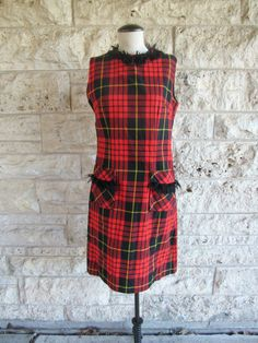 Vintage 60s mod plaid dress. Great casual dress with preppy mod style. Sleeveless with yarn fringe at collar and on pockets. Super unique. Gorgeous holiday red plaid that is totally in style right now. Dry clean only  Size - Medium. Around a size 6 or size 7. Chest - 36 inches, Waist - 32, Length of skirt - 38 inches Brand - Kennys Classics Material - Wool Condition - Excellent. No holes, stains, or rips.  Feel free to message me if you have any additional questions. Check out my other…