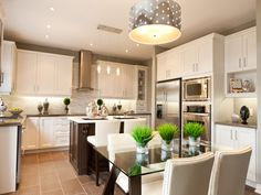 i like the white cabinets with the dark island....