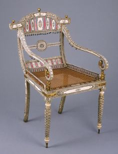 Chair..Probably made in Vishakhapatnam, Andhra .  Engraved and stained ivory; gilded wood and brass; cane seat    India, 1800