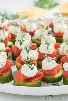 These little Cucumber and Smoked Salmon Appetizer Bites are as delicious as they are pretty. They make a perfect light start to a dinner and are a hit at any party. And don't worry, assembling them is much easier (and faster) than it looks. | theendlessmeal.com | #appetizers #wedding #weddingshower #bridalshower #babyshower #spring #glutenfree #healthyappetizer #partyfood