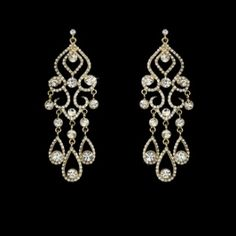 """Sparkling and exquisite, these gold plated earrings feature a rhinestone encrusted chandelier design that will coordinate beautifully with your white or ivory dress. The earrings measure 3-1/2"""" long."""