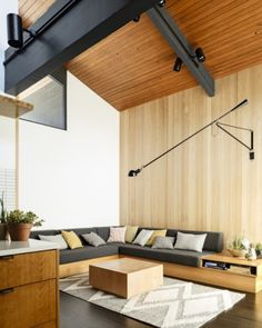 I like the idea of a projecting wall light like this. 14 Photos Of A Flawlessly Cool Mid-Century Modern Home | Airows