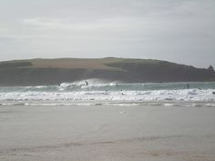 Surfers on Harlyn Bay, Cornwall Lovely caravan close to harlyn bay cornwall Trevose Head, Famous Fish, North Cornwall, Surfers, Caravans, Rafting, To Go, England, Sea