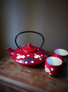 Vintage Asian Japanese Korean Chinese cherry blossom tea pot set  two cups Holiday gift. $39.99, via Etsy.