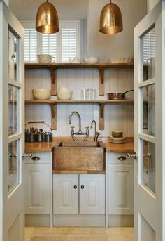 Small Kitchen Ideas - A small-space Artisan kitchen that incorporates lots of storage, a dishwasher, oven, coffee machine and hand-beaten copper sink. Kitchen Pantry, New Kitchen, Kitchen Interior, Kitchen Dining, Kitchen Decor, Kitchen Cabinets, White Cabinets, Kitchen Sinks, Kitchen Nook