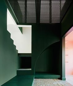 A Barcelona home uses shadesof green, pink, and blue to delineate space