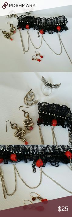 Jewelry lot with lace skull choker two earrings This is a lot that I put together with a handmade lace choker that has red stone skulls and chains.pretty rhinestone embellishments.  there is one vintage Crystal pair of earrings in red  one vintage snake pin  a skull and Wing adjustable ring  and handmade snake with rhinestone earrings Please ask any questions before purchasing no further discounts whole lot must be purchased items will not be sold individually Jewelry