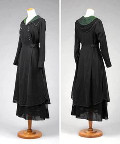 Black dress, ca. 1910-19, with V-neck and relaxed notched collar. Front has central panel with multicolored beads along each side. Back panel gives way to light overskirt. Belted at natural waist. Goldstein Museum of Design, Univ. of Minn.