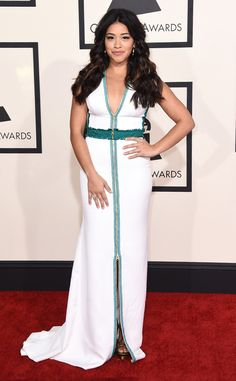 2015 Grammys: Red Carpet Arrivals  Gina Rodriguez wearing Christos Costarelloso white gown with teal piping highlights.