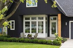 Vertical siding, extravant greenery, and dark colors are just a few of the exterior home trends and design elements that you can expect to see this year. House Paint Exterior, Exterior Paint Colors, Exterior House Colors, Exterior Design, Minneapolis, Cabana, Beautiful Modern Homes, Beautiful Interiors, Farmhouse Paint Colors
