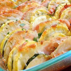 Zucchini and Summer Squash Casserole - we had this for supper tonight .  I added some grated Parmesan cheese, then the cheddar cheese.  It did take longer to cook than the recipe states (potatoes were underdone at stated time). . but oh was this YUMMY!