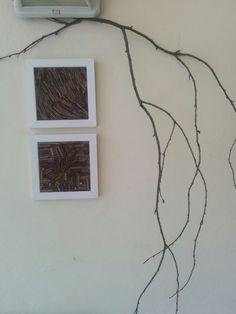 composizione di due quadretti con mosaico di bastoncini di ciliegio e rametto secco