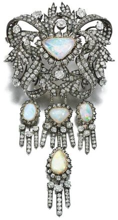 OPAL AND DIAMOND CORSAGE ORNAMENT,    MID 19TH CENTURY.   Designed as a series of ribbons and leaves, to a central cabochon opal within a floral border, set with cushion-shaped, circular-cut and rose diamonds, suspending a series of four tassels similarly set, brooch fitting; further accompanied by a jabot pin, each terminal set an oval cabochon opal within surrounds of cushion-shaped and circular-cut diamonds.
