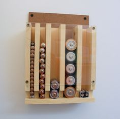 Natural Wood Battery Organizer.  Great to keep track of your battery needs. Helps you know when you need to restock. No mess. No problem.