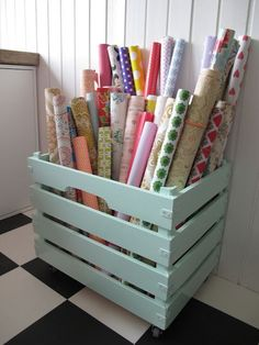 Crate for wrapping paper organization... Could look cute in the craft room!