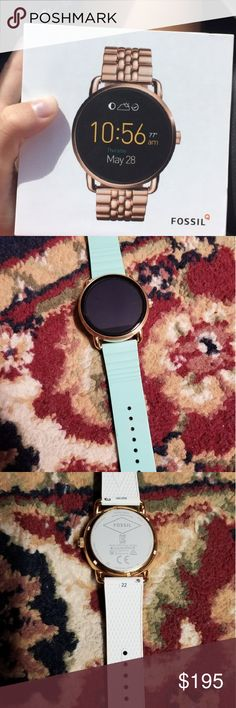 Fossil q wander smart watch Like new rose gold fossil q wander smart watch worn about 3 times has a screen protector on it comes with 2 interchangeable straps one of them is the original and the other I bought from the fossil website which is the mint green shown in picture. Fossil Accessories Watches