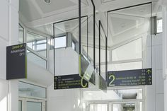 Creating a less permanent version of this signage would create sleek and simplistic signage at your conference.  Dramatically large frames with signage in lower quarter allows light to come through and makes space more inviting:  Uni-Kilinik Greifswald