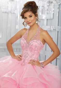 Dramatic and Elegant, This Quinceañera Ballgown Beautifully Combines an Intricately Beaded Bodice Featuring a Halter Neckline and Full Ruffled Skirt. Matching Bolero Jacket Included. Colors Available: Pink, Royal, Deep Aqua, White.