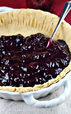 This low carb coconut flour pie crust is gluten free and easy to make! Add a low carb filling like blueberry sauce to complete this dessert!