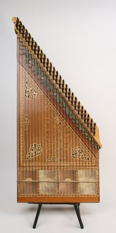 The kanun, an oriental zither, is a music instrument unique to Turkish music. This one is handmade and not the type found in tourist markets. While the kanun has been a traditional musical instrument in Turkey, there has been a great interest among people seeking out a special sound. What makes the kanun unique is the instrument is strung with nylon strings in contrast to a similar instruments such as zithers. Additionally, the bridge does not stand on a wooden soundboard but on a parchment…