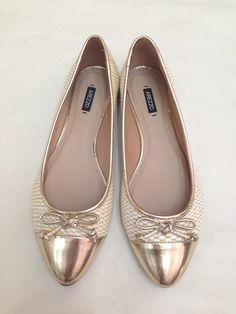 Arezzo gold flat shoes.