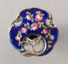 Lovely silver and enamel button with roses and scrolling leaves.
