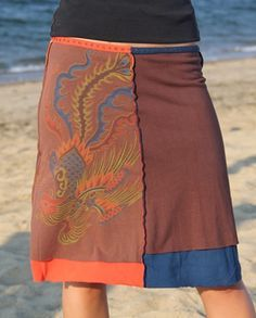 Make a T.shirt skirt - with any designs and colors - even length! You can also stencil them - fully customizable T. shirt skirt