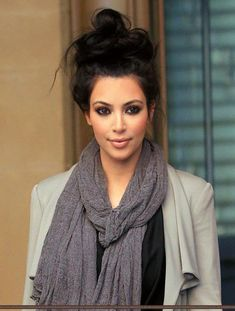 kim kardash rocks this messy bun, with beautiful smokey makeup, and a baggy sweater and scarf! effortless-ly chic!!! #love