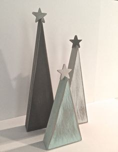 This set of wooden Christmas trees is a perfect addition to your holiday decor! This listing is for the set of 3 trees. a 9, 7, and 5 tree will come in this set. The trees are painted gray, white and aqua.
