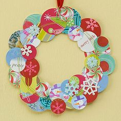 Greeting Cards Wreath  Select a palette of coordinating hues to create a whimsical wreath. Cut greeting cards into different-size circles. Arrange the circles into a wreath shape, overlapping as desired. Secure with crafts glue. Machine-stitch over the top using coordinating or contrasting thread. Attach a ribbon to the wreath with a colored paper clip and hang.