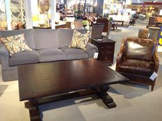 Leather occasional chair paired with a Century sofa, available in your choice of fabric, finishes and trim.