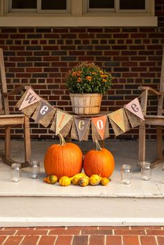 Decorate your porch with pumpkins and festive fall flowers for a fall-inspired 30th birthday party. Love these decoration ideas!