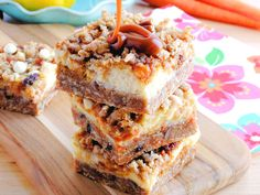 Carrot Cake Cheesecake Crumble Bars - a cross between carrot cake, cheesecake and Oatmeal Carmelitas! Our Carrot Cake Cheesecake Crumble Bars are packed with flavor and everything you dreamed they would be. The perfect Easter dessert treat. Carrot Cake Cheesecake, Cheesecake Recipes, Cheesecake Bars, Carrot Cake Bars, Carrot Cakes, Carrot Cake Cookies, Oreo Cake, Just Desserts, Delicious Desserts