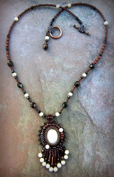 Natural Riverstone cabochon and beaded necklace with fringe. $35.00, via Etsy.