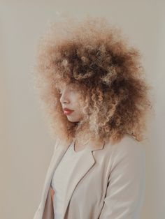 Beautiful Frizzy Afro hair. Frizz and shrinkage, it's the nature of curly, afro hair. Why fight it?