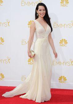 Lucy Liu in Zac Posen gown, Jimmy Choo 'Cloud' clutch and Lorraine Schwartz jewelry – 2014 66th Emmy Awards
