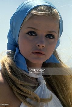Portrait of Swedish actress Ewa Aulin wearing a blue headscarf ...