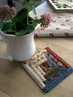 Small quilt - Log cabin coaster by Kathleen Tracy http://www.countrylanequilts.com/index.html