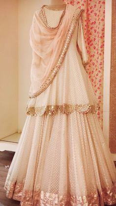 Beautifully draped cream and rose gold lehnga-understated elegance at its best. - Beautifully draped cream and rose gold lehnga-understated elegance at its best. Indian Wedding Outfits, Bridal Outfits, Indian Outfits, Sharara Designs, Lehenga Designs, Pakistani Dress Design, Pakistani Outfits, Pakistani Clothing, Bollywood
