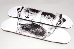 a skateboard with just a moustache on it is a great, great idea