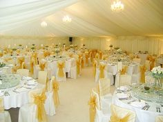 white with yellow | Simple, elegant marquee wedding reception