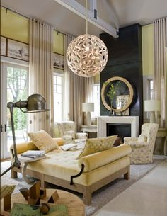 Sustainable balsa wood pieces fit together to form the lacy pendant light in this elegant, sustainable living room. - Traditional Home ® / Photo: Gordon Beall