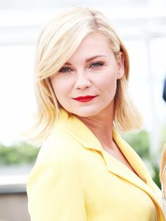 Kirsten Dunst's punch red lip is the perfect finishing touch to her retro outfit.