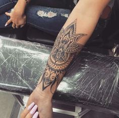 Mandala-style lower forearm tattoo-- completely obsessed with the detail and line work.